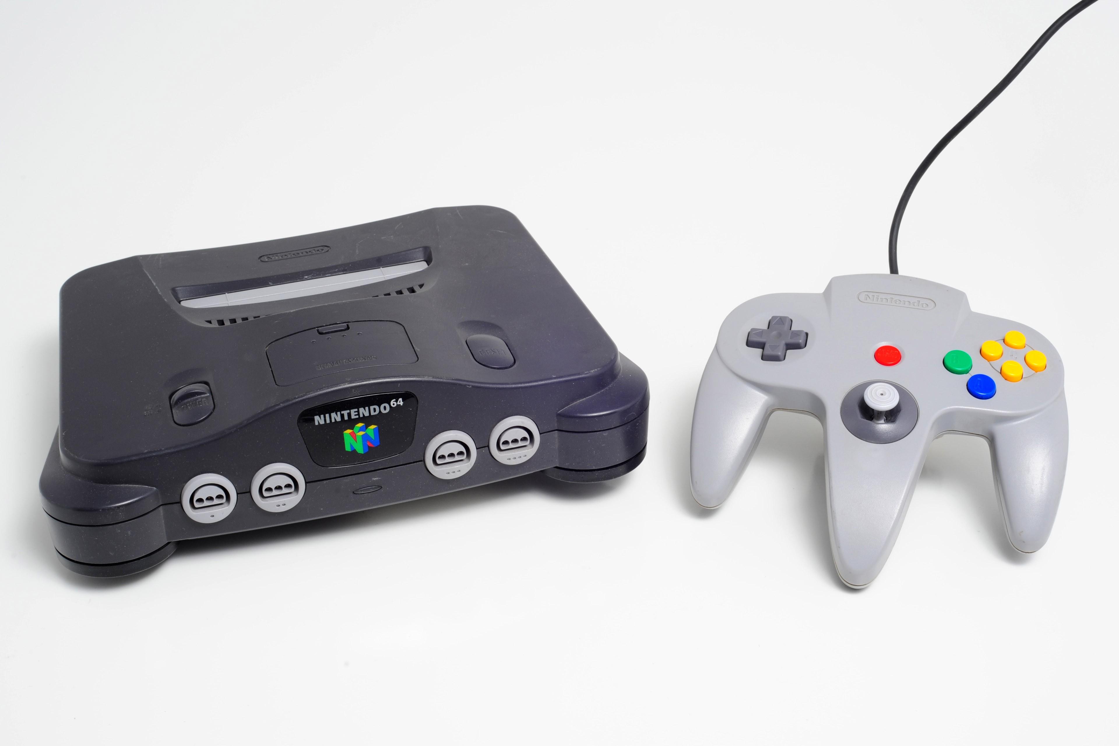 Console complète Nintendo N64, 1x manette originale N64, et fils de branchement.